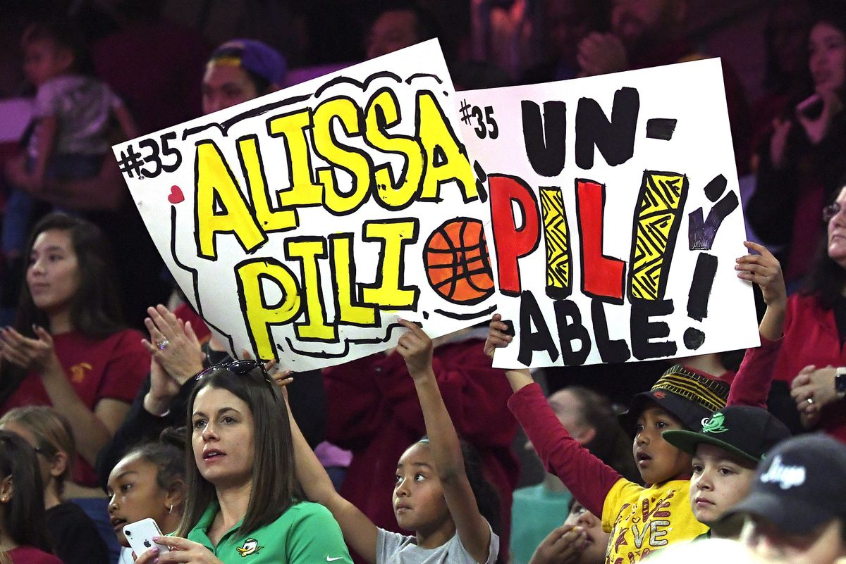 Fans hold up signs for Southern California forward Alissa Pili during a game in Los Angeles earlier this season. (AP Photo/Mark J. Terrill)