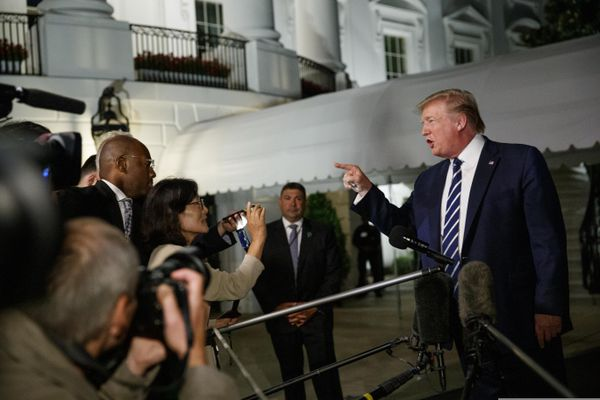 President Donald Trump speaks with reporters as he walks to Marine One on the South Lawn of the White House, Friday, Aug. 23, 2019, in Washington. Trump is en route to the G-7 summit in France. (AP Photo/Alex Brandon)
