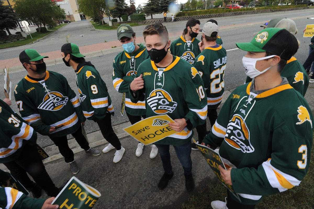UAA junior forward Tanner Schachle, center, joins other Seawolves at a protest after the team was targeted for elimination in August. (Bill Roth / ADN archive)
