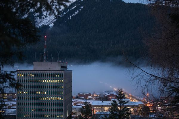 Traffic flows into downtown Juneau from Douglas Island on Wednesday, Jan. 16, 2019. The large building at left is the Federal Building. (Loren Holmes / ADN)