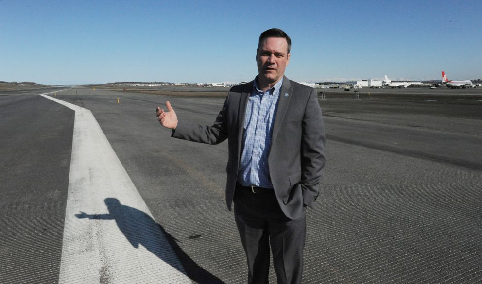 Airport manager Jim Szczesniak points out the widening of the north-south runway that was done during construction last summer at Ted Stevens Anchorage International Airport on Thursday, March 28, 2019. The remaining 80 percent of the runway will be widened from 150 feet to 200 feet during construction this summer. (Bill Roth / ADN)