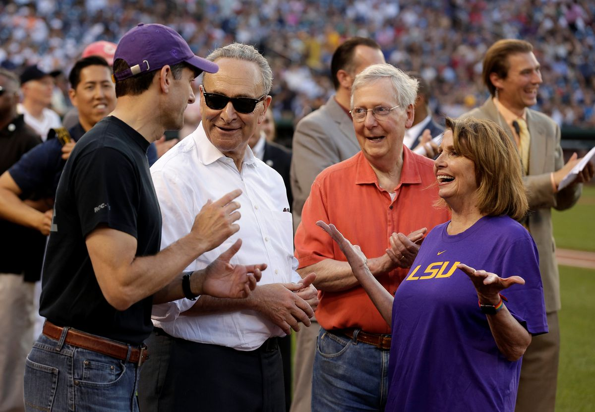 Speaker of the House Paul Ryan (R-WI), Senate Minority Chuck Schumer (D-NY), Senate Majority Leader Mitch McConnell (R-KY) and House Minority Leader Nancy Pelosi (D-CA) speak before the Democrats and Republicans face off in the annual Congressional Baseball game at Nationals Park in Washington, U.S., June 15, 2017. REUTERS/Joshua Roberts TPX IMAGES OF THE DAY