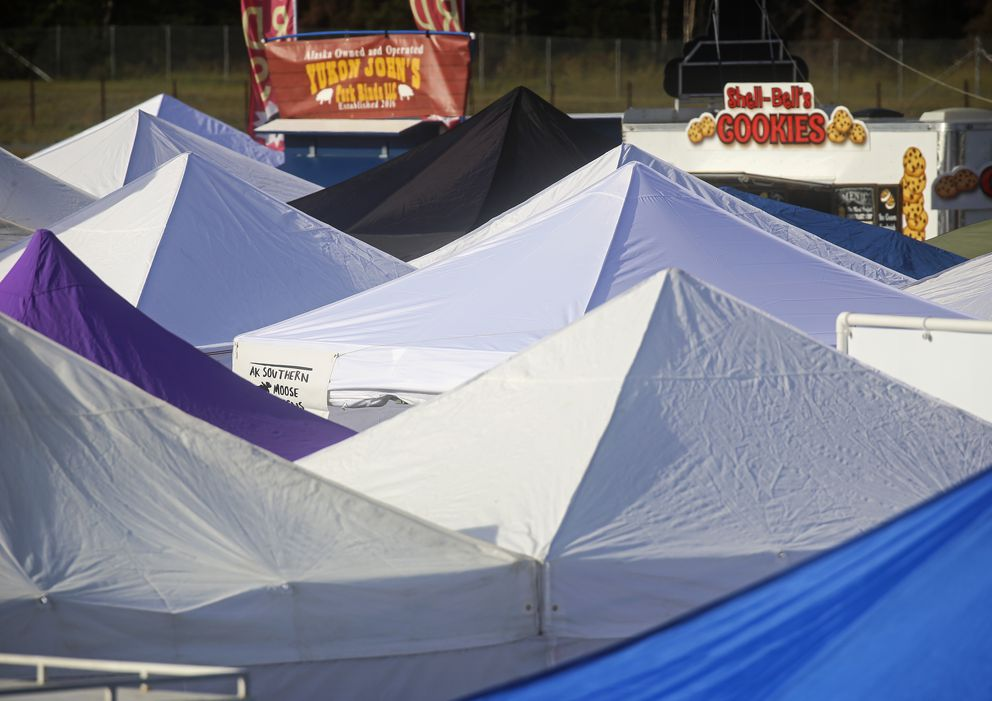 Vendor tents line the concrete across from the raceway during the first day of the Mat-Su Fall Festival at the Alaska Raceway Park in Palmer. (Emily Mesner / ADN)
