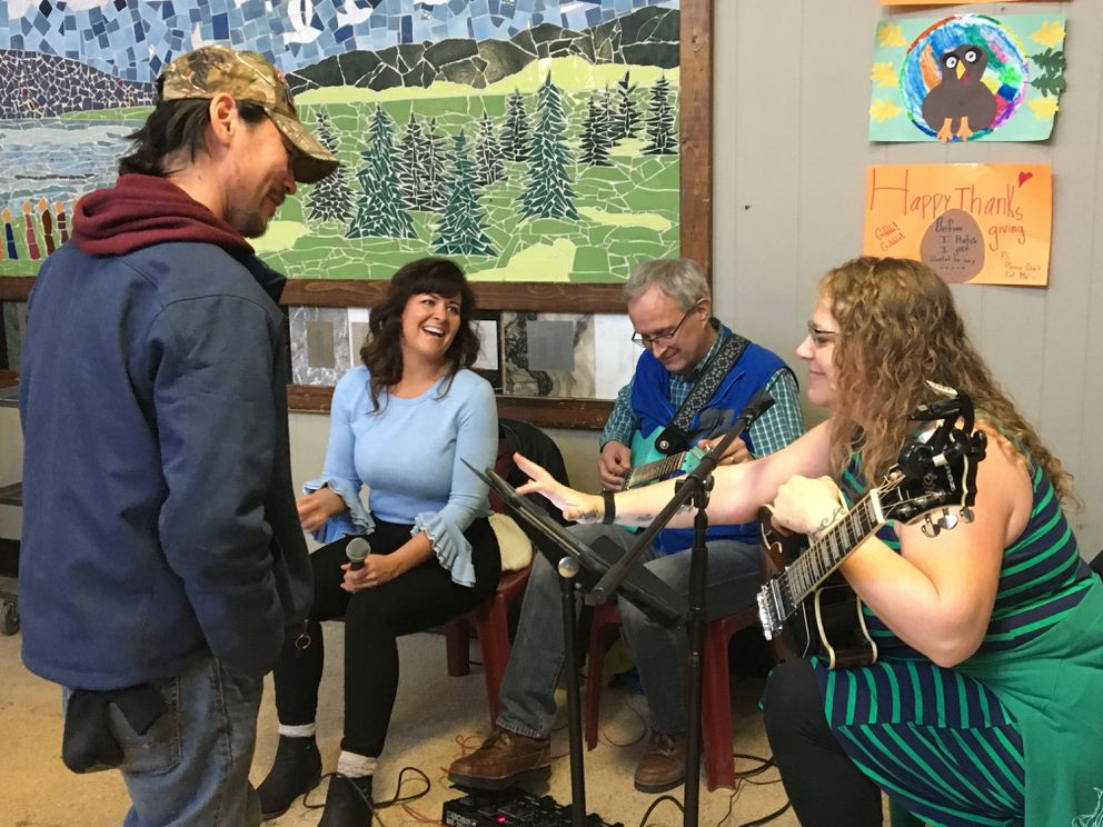 A soup kitchen patron who identified himself by his first name, Henry, requests a song from live musical entertainers at Bean's Cafe on Thursday, Nov. 22, 2018. (Madeline McGee / ADN)