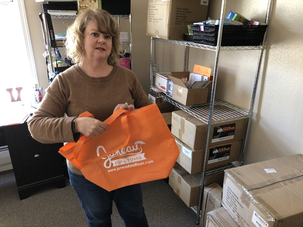 Midgi Moore of Juneau Food Tours explains Friday, April 17, 2020 how she is planning to send samples of Alaska-made food products to customers. With cruise ship visits to Alaska canceled, Moore has lost almost her entire business. (James Brooks / ADN)