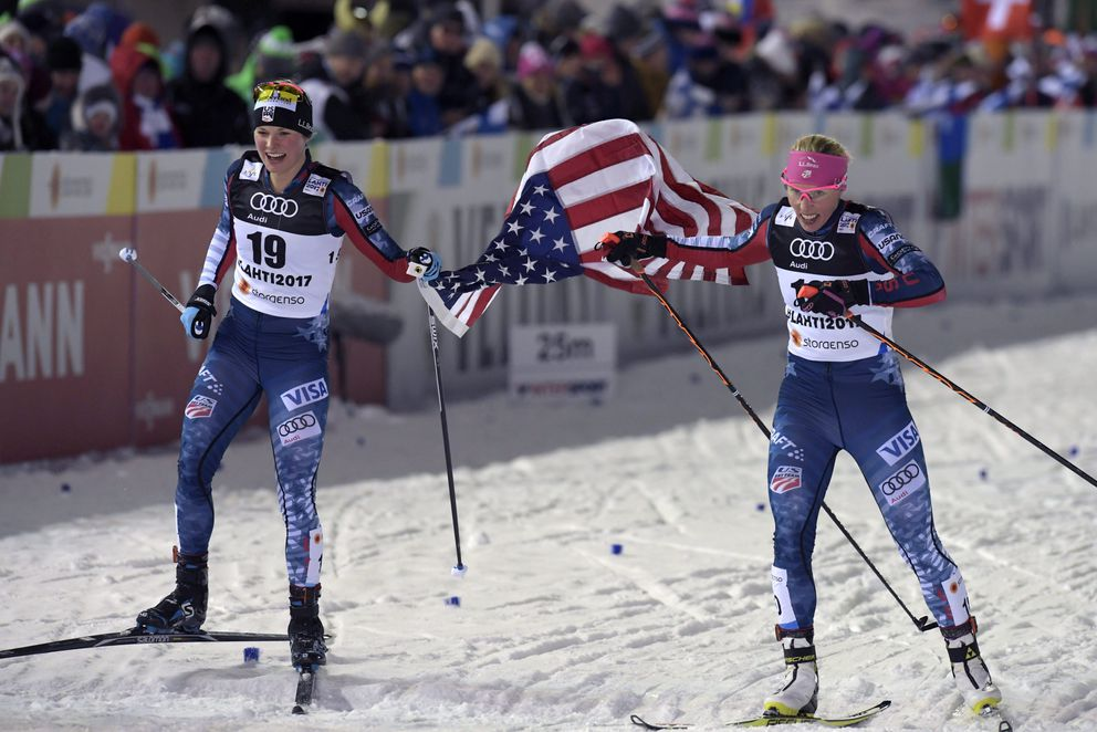 Americans Jessie Diggins, left, and Kikkan Randall of Anchorage celebrate after finishing second and third respectively on Thursday in the World Championships cross-country sprint finals in Lahti, Finland. (Lehtikuva / Markku Ulander via Reuters)