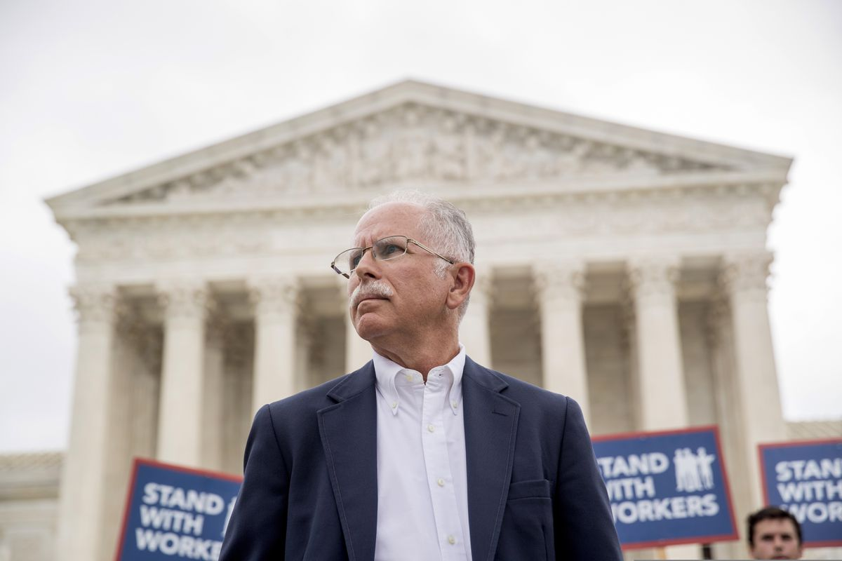FILE - In this Wednesday, June 27, 2018, file photo, plaintiff Mark Janus stands outside the Supreme Court after the court rules in a setback for organized labor that states can't force government workers to pay union fees, in Washington. Union membership among public employees has fallen only slightly in the nation's most unionized states since the Supreme Court ruled in 2018 that government workers no longer could be required to pay union fees, according to an analysis of federal data conducted for The Associated Press. (AP Photo/Andrew Harnik, File)