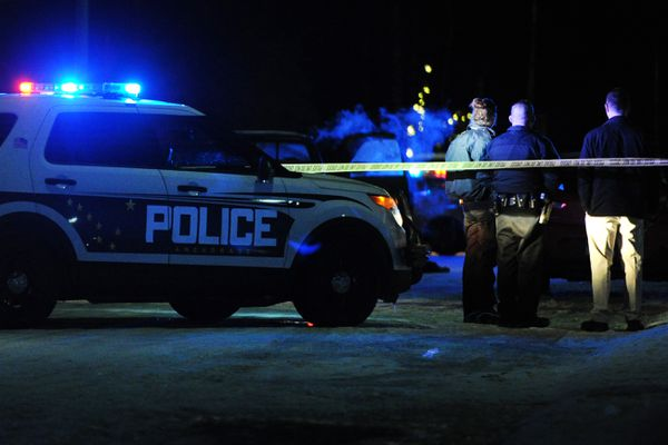Anchorage Police investigate the scene of a double homicide in West Anchorage on Sunday, Dec. 9, 2018. (Bill Roth / ADN)