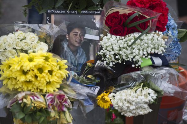 A photo of Raynaldo Khotesouvan is surrounded by flowers. (Marc Lester / ADN)