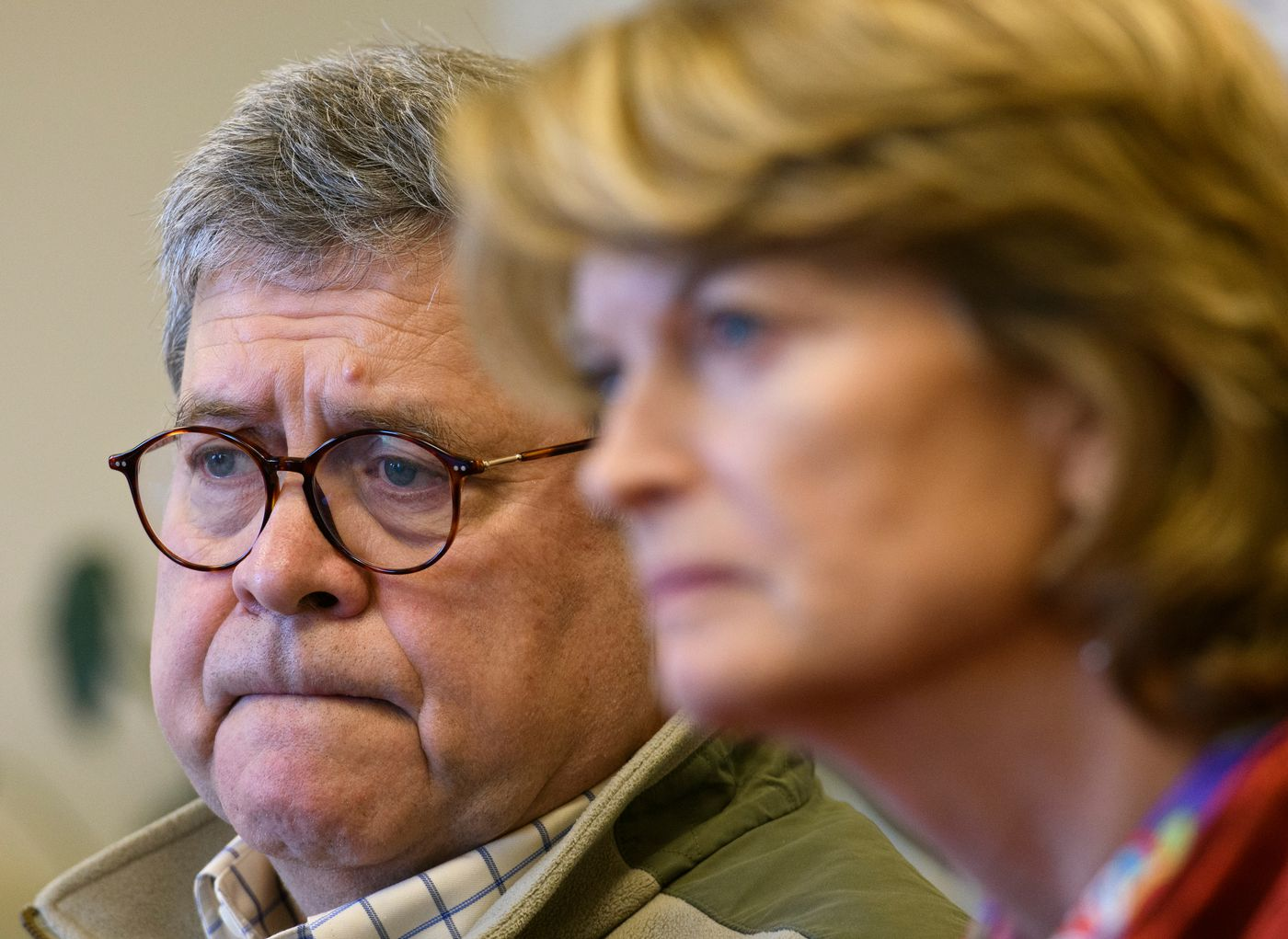 U.S. Attorney General William Barr, left, and Sen. Lisa Murkowski listen to staff of the Tundra Women's Coalition, a shelter for victims of domestic violence and sexual assault, at the facility in Bethel. Barr visited Bethel and Napaskiak Friday, May 31, 2019 to learn about law enforcement and public safety challenges in the region. (Marc Lester / ADN)