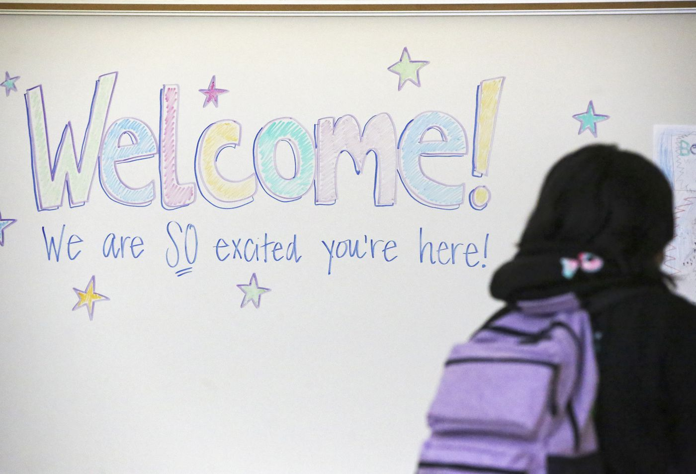 A student walks toward her classroom at Begich Middle School on Tuesday. (Emily Mesner / ADN)