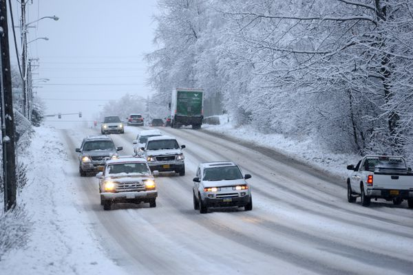 Anchorage's first real snow of the season fell early Friday morning, Oct. 21, 2016. Drivers take care on the snow-slickened Lake Otis Boulevard. (Anne Raup / Alaska Dispatch News)
