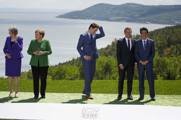 Justin Trudeau, Canada's prime minister, center, joins other leaders for a photo shoot during the Group of Seven Leaders Summit in La Malbaie, Quebec, Canada, on June 8, 2018. Also shown are British Prime Minister Theresa May, from left; German Chancellor Angela Merkel; French President Emmanuel Macron; and Japanese Prime Minister Shinzo Abe. MUST CREDIT: Cole Burston/Bloomberg