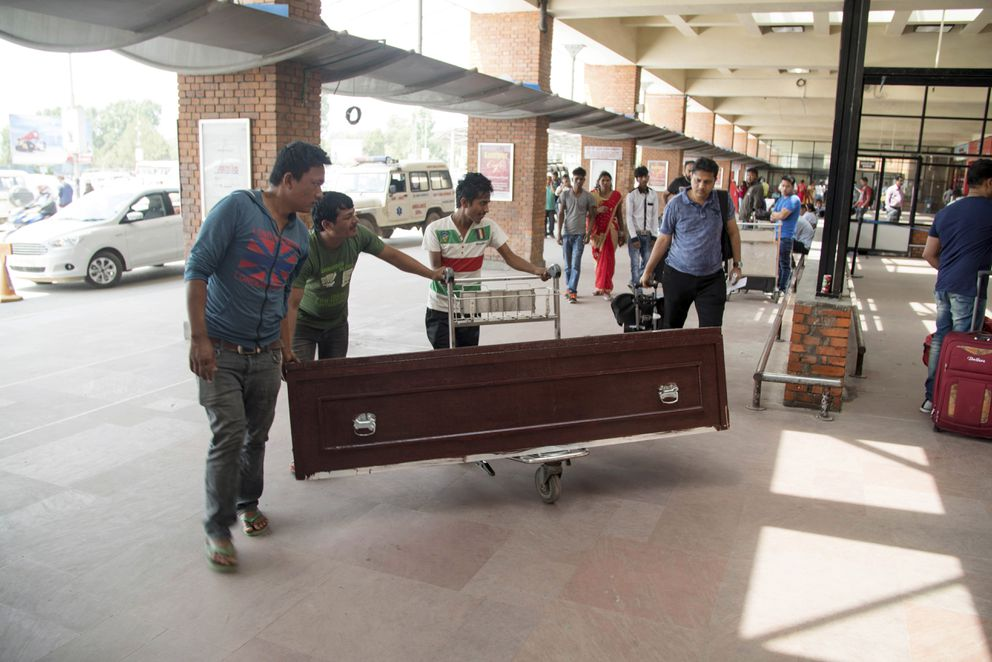 The coffin holding Goutam Ghosh's body arrives at the airport in Kathmandu, Nepal, en route to Kolkata, India, June 1, 2017. (Rajneesh Bhandari/The New York Times)