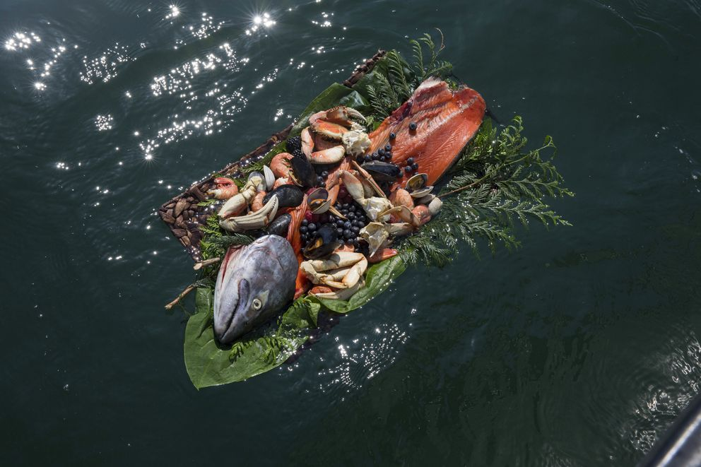 A salmon basket floats in the Skagit River after being placed there during the annual blessing of the fleet on the Swinomish tribe's reservation in Washington state, May 17, 2018. The U.S. Supreme Court on Monday sided with the tribe in a decadeslong legal battle over whether the state must repair salmon habitats. (Ruth Fremson/The New York Times)