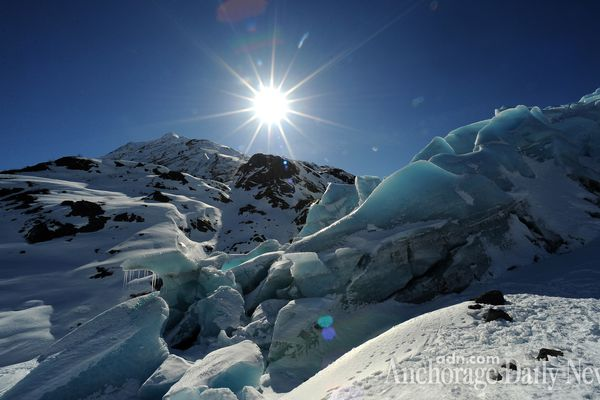 The sun shines above Portage Glacier on Wednesday, April 2, 2014.