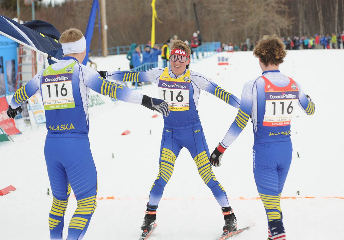 Gus Schumacher, center, skis toward teammates Karl Danielson, left, and Kai Meyers, right, after lifting the team to gold in Saturday's relay races at the U.S. Junior National cross-country ski championships at Kincaid Park. (Photo by Michael Dinneen).