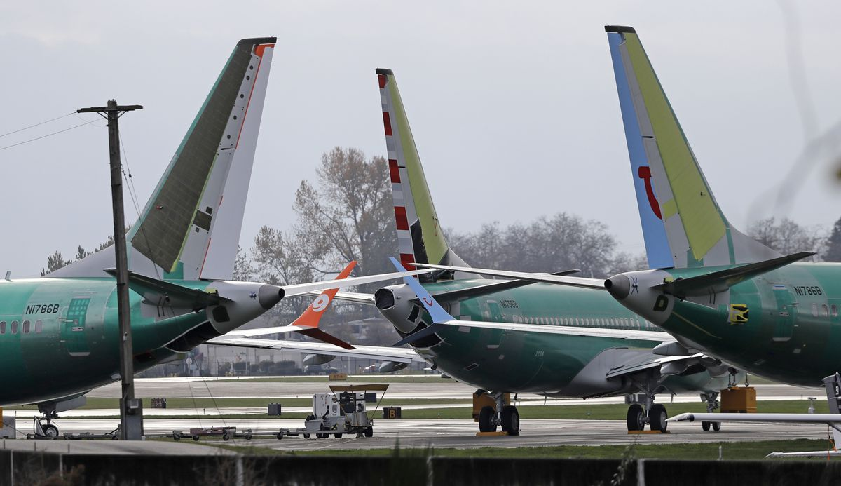 FILE- In this Nov. 14, 2018, file photo Boeing 737 MAX 8 planes are parked near Boeing Co.'s 737 assembly facility in Renton, Wash. (AP Photo/Ted S. Warren, File)