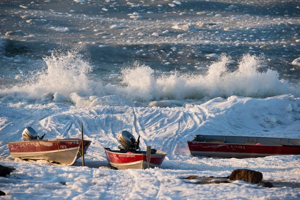 Waves crash on the Bering Sea shoreline in Savoonga on April 19. Many in the village say this spring was the earliest they can remember ice going out, something that complicates walrus hunting. (Marc Lester / Alaska Dispatch News)