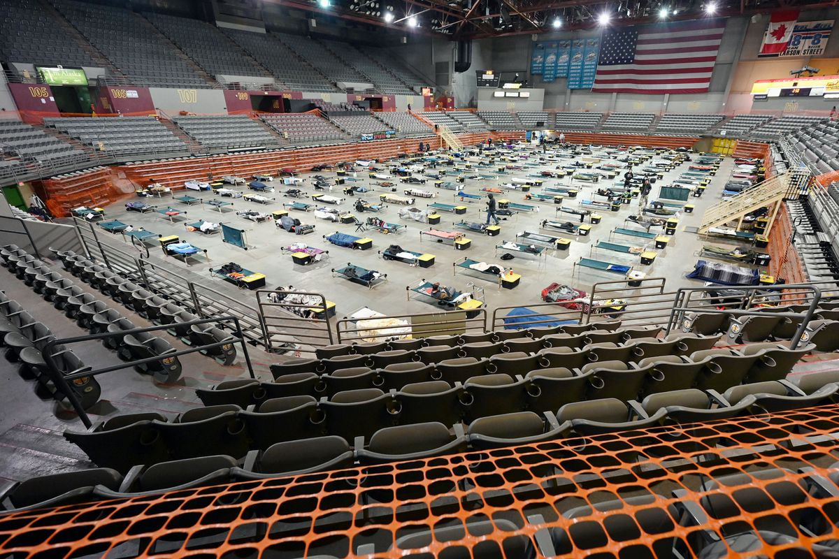 Cots on the floor of the mass emergency shelter operated by Bean's Cafe in the Sullivan Arena in February 2021. (Bill Roth / ADN)