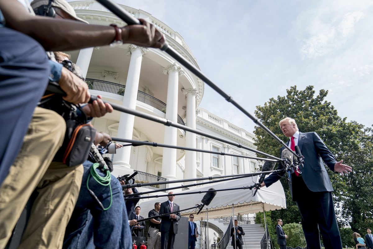 President Donald Trump speaks to members of the media before boarding Marine One on the South Lawn at the White House in Washington, Friday, Aug. 17, 2018, for a short trip to Andrews Air Force Base, Md., and then on to Southampton, N.Y., for a fundraiser. (AP Photo/Andrew Harnik)