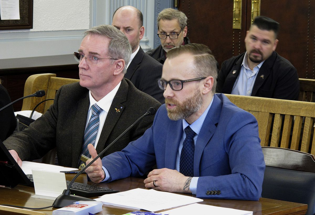 Andy Jones, right, director of the Alaska Office of Substance Misuse and Addiction Prevention, speaks before the Senate Finance Committee on Thursday, Feb. 7, 2019, in Juneau, Alaska. Shown beside him is Michael Duxbury, deputy commissioner of the state Department of Public Safety. (AP Photo/Becky Bohrer)