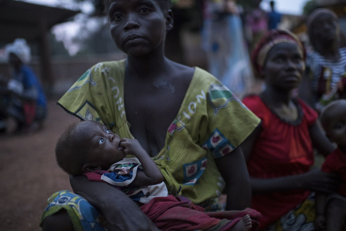 Collette Lundi holds her severely malnourished 8-month-old son, Serge Mbagawan, at a hospital run by an aid group called Alima in Boda, Central African Republic, March 11, 2018. The Central African Republic is arguably the capital of human misery, yet the United Nations says that its humanitarian plan for the country is only 2 percent funded. (Lynsey Addario/The New York Times)