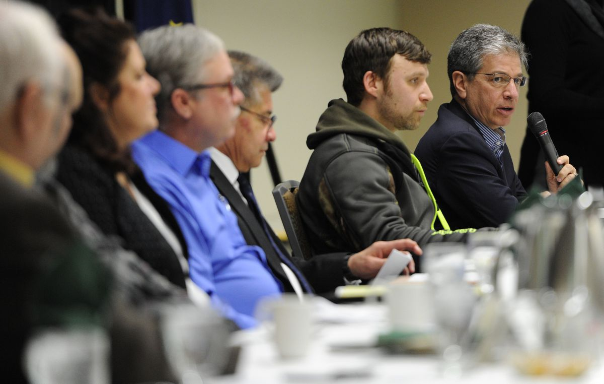 """Mayor Ethan Berkowitz answers a question as seven mayoral candidates participated in the Anchorage Chamber of Commerce's """"Make It Monday """" forum at the Dena'ina Center on Monday, Feb. 26, 2018. (Bill Roth / ADN)"""