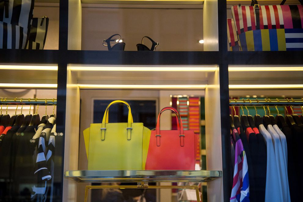 Kate Spade merchandise in a New York store in 2016; for the author, investing in a Kate Spade bag meant that adult life was going to be fun, not boring. (Bloomberg photo by Michael Nagle)