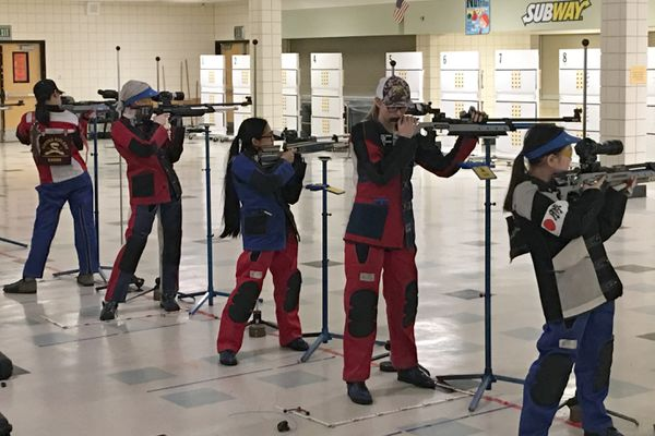 Left to right: Stephanie Chung, Mackenzie Rogers, Jerica Manaois, Savannah Woodke, Jasmine Kobayashi of the The Dimond High School riflery A team. They tied a 2009 Cook Inlet Conference record of 1,162 today. (John Snead / Dimond High School)