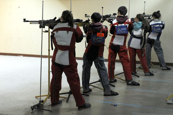 ERIK HILL / Anchorage Daily News The Dimond team takes aim at the T-Bird Invitational riflery meet Tuesday November 15, 2011 at East.
