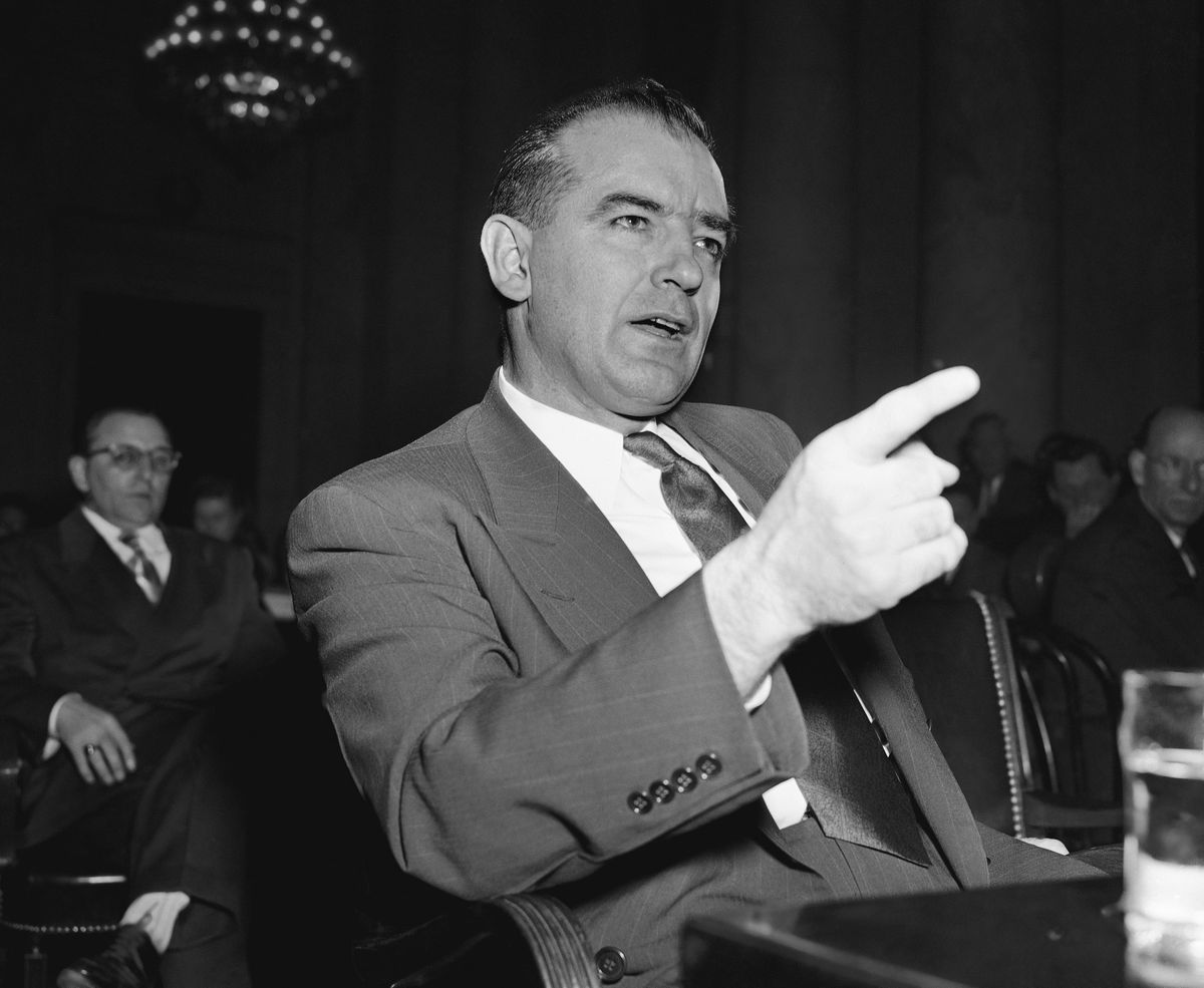 In this March 9, 1950 file photo, Sen. Joseph McCarthy, R-Wis., gestures during a Senate subcommittee hearing on McCarthy's charges of communist infiltration of the U.S. State Department. President Donald Trump, tweeting over the weekend, invoked both McCarthyism and the Watergate scandal, two of the most-debated chapters of recent American political history. (AP Photo/Herbert K. White)