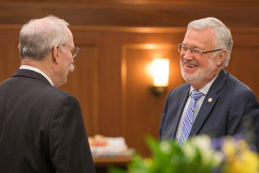 Sen. Gary Stevens, R-Kodiak, speaks with Sen. Bert Stedman, R-Sitka, on the floor Wednesday, Jan. 16, 2019 at the Alaska State Capitol. (Loren Holmes / ADN)
