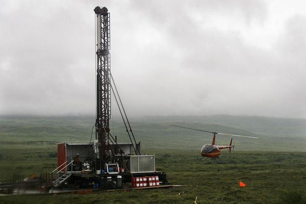 A helicopter lands near a test drilling site for the Pebble Mine in Southwest Alaska on July, 23, 2007.