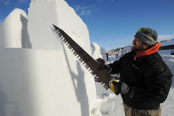 Jesse Mellor of AK Awesome works on a snow sculpture entitled