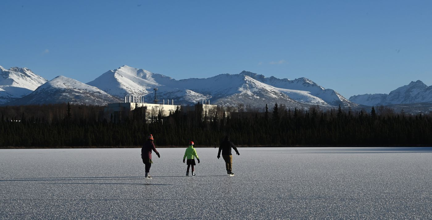 Three skaters take in the smooth ice of Goose Lake on Sunday, Nov. 1, 2020. (Anne Raup / ADN)