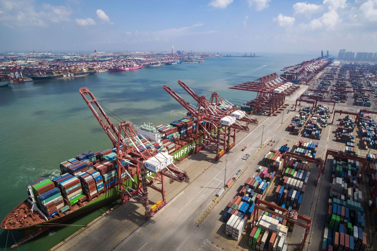 A container ship is docked a port in Qingdao in eastern China's Shandong province. (Chinatopix via AP)