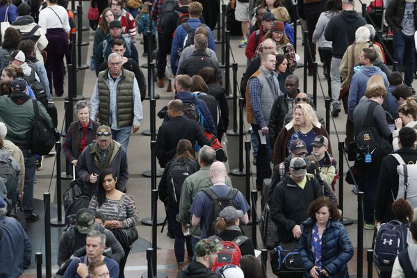 FILE - In this Nov. 21, 2018, file photo, travelers wait in long lines to pass through a security checkpoint at Denver International Airport in Denver. Thanksgiving travel is an ordeal under the best of circumstances, and a one-two punch of bad weather threatens to make it even more exhausting. There's a forecast for heavy snow in Denver, and another storm will crash into the West Coast, possibly fouling flights and making driving treacherous. (AP Photo/David Zalubowski, File)