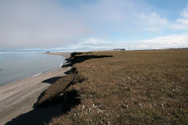 Mammoth chunks of shoreline are falling prey to accelerated shoreline erosion throughout Alaska. Erosion along the shore near Barter Island Long Range Radar Site, adjacent to Kaktovik, was quite evident in this photo from August 2008. Coastal erosion is evident throughout a vast portion of the Alaskan coast. (Tommie Baker / U.S. Air Force)