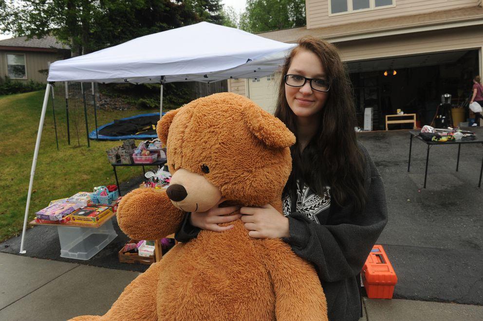 Madisen Scott with her giant Teddy bear-find. (Bob Hallinen / Alaska Dispatch News)