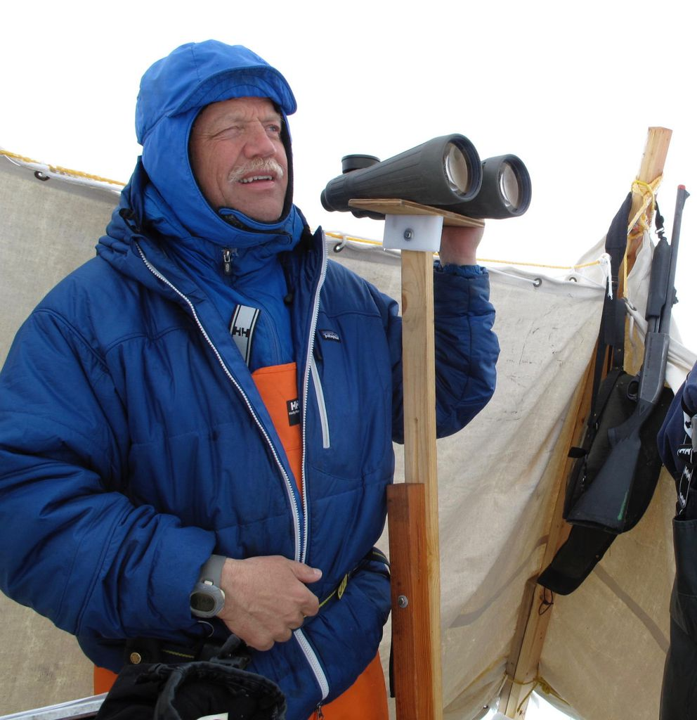 Craig George looks for migrating bowhead whales north of Utqiagvik in May 2010. (Ned Rozell)