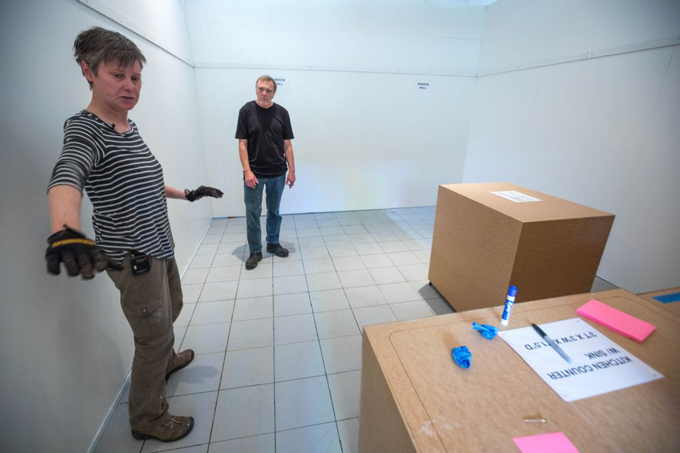 Wyne and Farnsworth work on the apartment mock-up. (Loren Holmes / Alaska Dispatch News)
