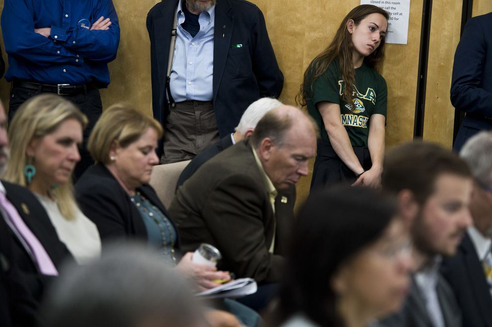 Tere Alonso, a UAA gymnast, listens to discussion at top right. The University of Alaska Board of Regents met at UAA to discuss restructuring the university in the face of budget cuts on July 30, 2019. (Marc Lester / ADN)