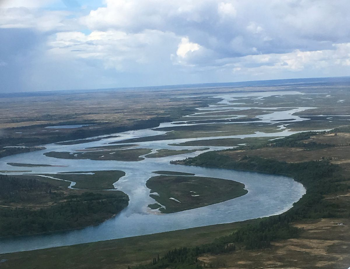 The shallow, braided Kvichak River proved too much for the Catch 22, a commercial fishing boat making its way from Homer to Bristol Bay via a land route. (Photo by Alli Harvey)