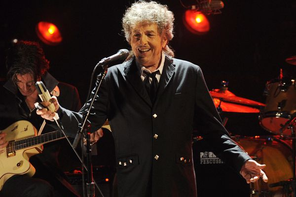 """FILE - In this Jan. 12, 2012, file photo, Bob Dylan performs in Los Angeles. Universal Music Publishing Group is buying legendary singer Bob Dylan's entire catalog of songs. The company said Monday, Dec. 7, 2020, that the deal covers 600 song copyrights including """"Blowin' In The Wind,"""" """"The Times They Are a-Changin',"""" and """"Knockin' On Heaven's Door,"""" """"Tangled Up In Blue."""