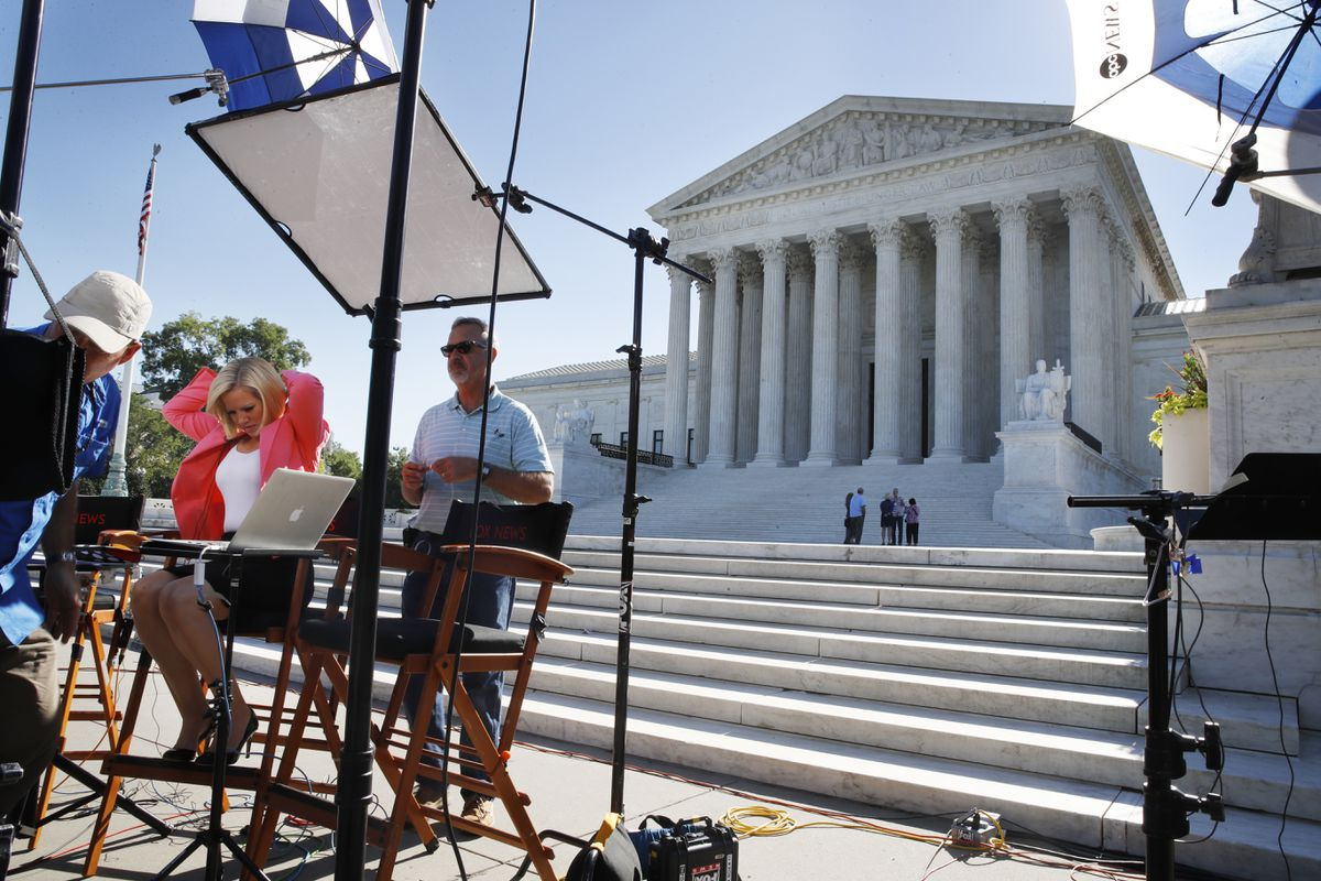 Television crews set up in front of the Supreme Court, Monday, July 9, 2018, in Washington. President Donald Trump is expected to announce his choice on a replacement for retiring Supreme Court Justice Anthony Kennedy Monday evening. (AP Photo/Jacquelyn Martin)