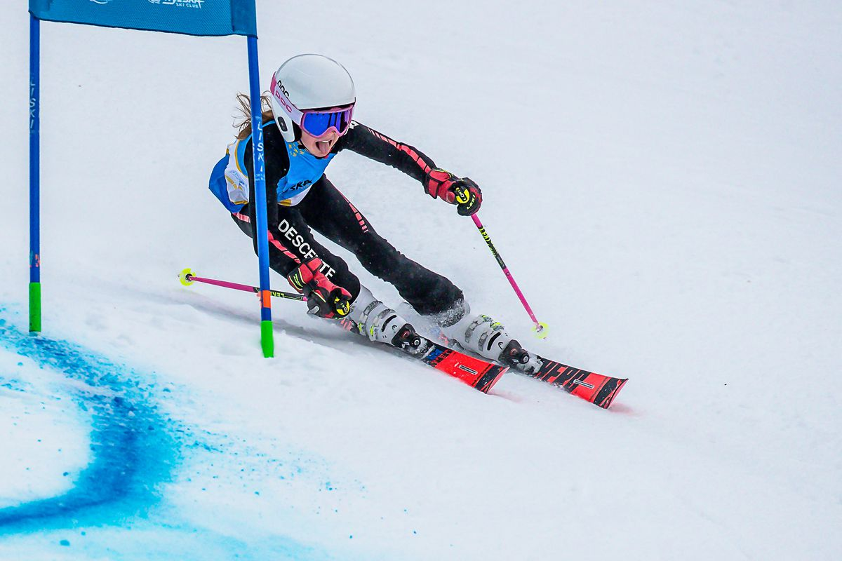 Arctic Valley Ski Team's Reese Woodward squeezes past a gate in winning the U12 class in the first of two Alyeska Cup giant slaloms Sunday on Alyeska's Race Trail. Ava Murphy won the second U12 race. (Photo by Bob Eastaugh)