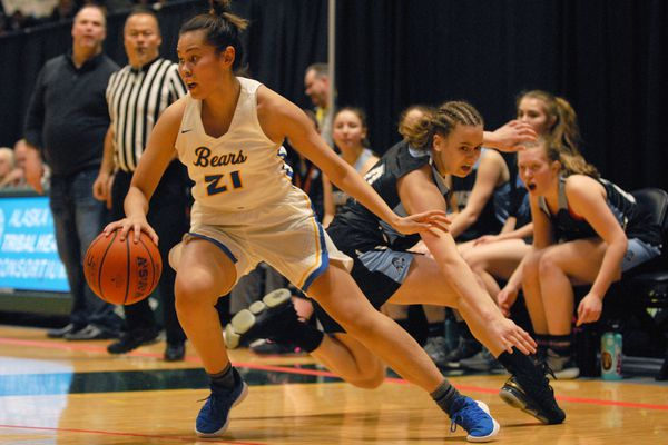 Bartlett's Sasha Saccheus evades the defense of Chgiak's Carol Houser during the Golden Bears' 54-44 win in the semifinal round of the ASAA/First National Bank Alaska Class 4A Girls Basketball Tournament at the Alaska Airlines Center in Anchorage on Friday, March 22, 2019. (Matt Tunseth / ADN)