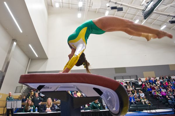 A UAA gymnast performs on the vault. UAA hosted Winona State in gymnastics on Saturday, January 10, 2015, at the Alaska Airlines Center.