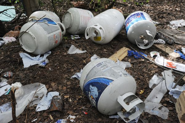 Propane tanks are scattered amongst the homeless camps along the Chester Creek Trail in Anchorage on Tuesday, May 15, 2018. (Bill Roth / ADN)